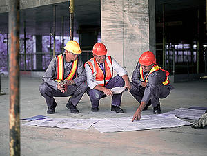 Workers and businessman on site