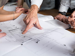 Hand pointing on construction plan